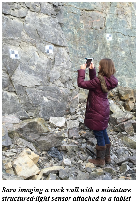 Sara imaging a rock wall with a miniature structured-light sensor attached to a tablet