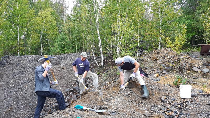 Luke, Steven and Andrew digging a pit in the Ore Chimney waste-rock pile.